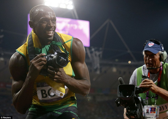 Usain Bolt shooting some after-action snapshots with Swedish photographer Jimmy Wixtröm's camera. Image (c) Reuters