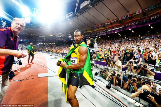 Silver medalist Yohan Blake looks surprised by Usain's antics. Image © Usain Bolt / Aftonbladet